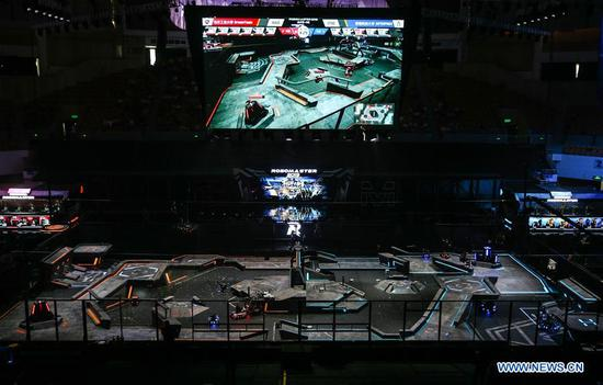 Robots compete during the finals of the 18th RoboMaster Robotics Competition in Shenzhen, south China's Guangdong Province, Aug. 6, 2019. The final tournament of the 18th RoboMaster Robotics Competition kicked off here on Tuesday, with 32 teams from home and abroad competing for the championship. (Xinhua/Jin Yu)