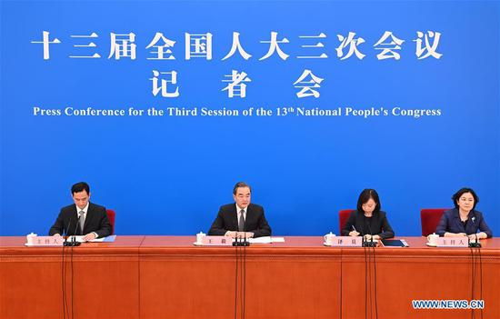 Chinese State Councilor and Foreign Minister Wang Yi attends a press conference on China's foreign policy and foreign relations via video link on the sidelines of the third session of the 13th National People's Congress (NPC) at the Great Hall of the People in Beijing, capital of China, May 24, 2020. (Xinhua/Chen Yehua)
