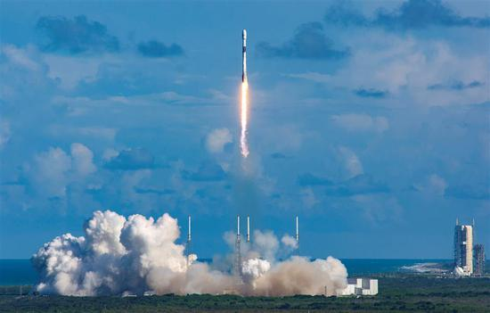 This handout photo taken on Monday and received on Tuesday from South Korea's Defense Acquisition Program Administration shows a Falcon 9 rocket carrying the ANASIS-II satellite blasting off from Cape Canaveral Air Force Station in Florida.