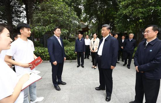Chinese President Xi Jinping, also general secretary of the Communist Party of China Central Committee and chairman of the Central Military Commission, talks with students while visiting a memorial facility dedicated to Zhang Zhongjing, a famous Chinese pharmacologist and physician of the Eastern Han Dynasty (25-220), in Nanyang, central China's Henan Province, May 12, 2021. Xi Jinping on Wednesday inspected the city of Nanyang in Henan Province. (Xinhua/Ju Peng)
