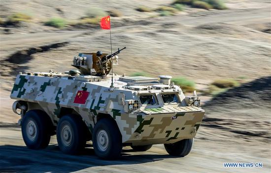 An armored vehicle operated by a Chinese crew drives during a match of the International Army Games 2018 in Korla, northwest China's Xinjiang Uygur Autonomous Region, Aug. 4, 2018. Three contests of the International Army Games 2018 in northwest China's Xinjiang Uygur Autonomous Region ended here Wednesday. (Xinhua/Yin Along)