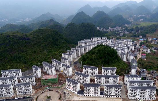 Aerial photo taken on Oct. 15, 2018 shows a view of the Songping settlement for poverty relief relocation in Shadaogou Township of Xuan'en County, central China's Hubei Province. (Xinhua/Song Wen)