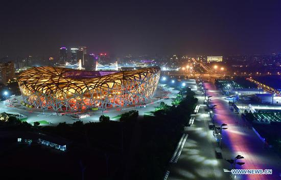 Photo taken on May 14, 2019 shows the night view of the National Stadium, also known as the Bird's Nest, in Beijing, capital of China. Roads and buildings were illuminated Tuesday evening before the upcoming Conference on Dialogue of Asian Civilizations (CDAC) in Beijing. (Xinhua/Li He)