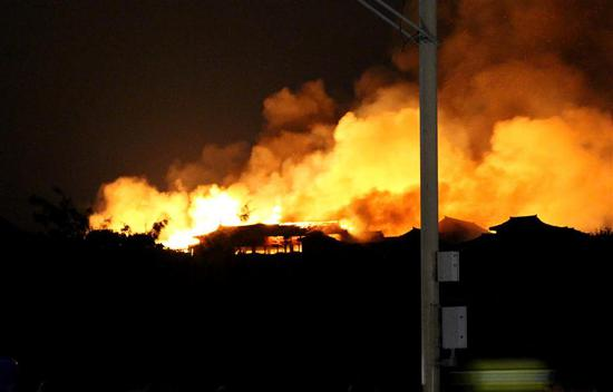 Shuri Castle is engulfed in flames in Naha, Okinawa prefecture, southern Japan on early October 31.