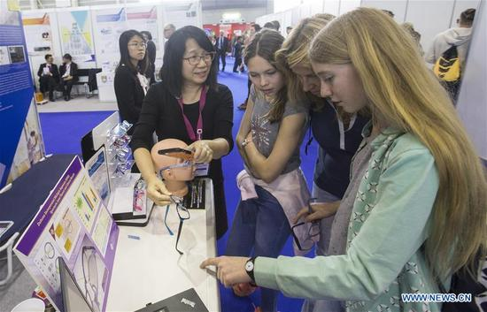 People visit the exhibition area of China's Hong Kong at the 46th International Exhibition of Inventions of Geneva, in Geneva, Switzerland, April 11, 2018. The 46th International Exhibition of Inventions of Geneva kicked off on Wednesday. About 1,000 inventions from 40 countries and regions are displayed during the 5-day exhibition. (Xinhua/Xu Jinquan)