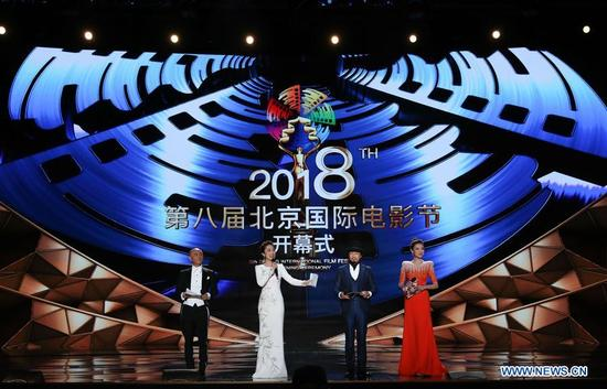 Hosts are seen during the opening ceremony of the 8th Beijing International Film Festival (BJIFF) in Beijing, capital of China, April 15, 2018. (Xinhua/Yin Gang)