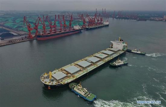 Aerial photo taken on July 9, 2018 shows a cargo ship which is about to anchor at Jingtang port area of Tangshan Port, north China's Hebei Province. The throughput of Tangshan Port reached 303 million tons from January to June this year, growing 7.28 percent year on year. (Xinhua/Yang Shiyao)