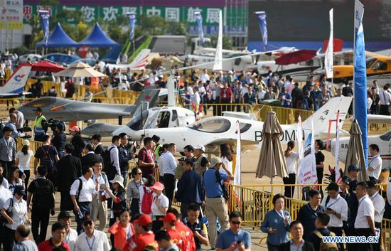 People visit the 12th China International Aviation and Aerospace Exhibition (Airshow China) in Zhuhai, south China's Guangdong Province, Nov. 6, 2018. Opening Tuesday in Zhuhai, the airshow runs until Nov. 11 and is attended by over 700 exhibitors from 40 countries and regions. (Xinhua/Deng Hua)