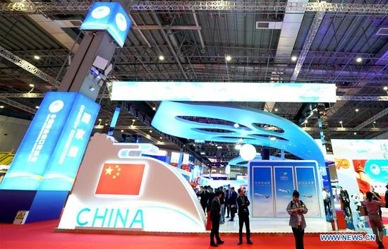 People visit the China pavilion during the second China International Import Expo (CIIE) in Shanghai, east China, Nov. 5, 2019. The China pavilion showcases achievements China has made over the past 70 years, as well as its culture and landscape. (Xinhua/Chen Jianli)
