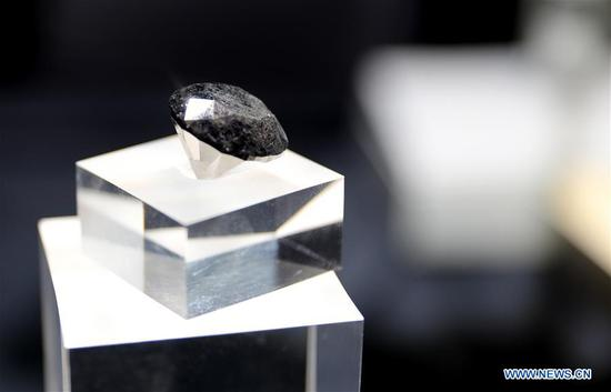 A black diamond weighing 88 carats is pictured in Shanghai, east China, Oct. 26, 2020. With an estimated value of 37 million U.S. dollars, the diamond from Paris will be on display during the upcoming third China International Import Expo (CIIE) in Shanghai. (Xinhua/Fang Zhe)