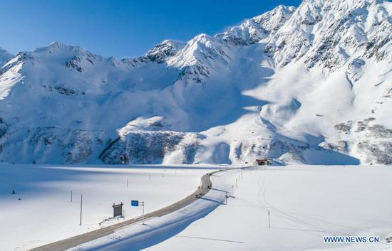 Aerial photo taken on Feb. 8, 2021 shows the entrance of Galongla Tunnel in Medog County, Nyingchi City of southwest China's Tibet Autonomous Region. (Xinhua/Sun Fei)