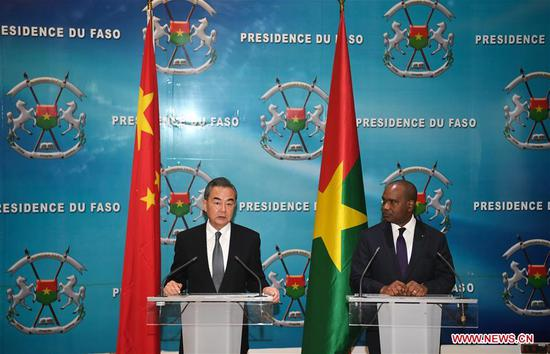 Chinese State Councilor and Foreign Minister Wang Yi (L) and Burkina Faso's Foreign Minister Alpha Barry attend a press conference in Ouagadougou, Burkina Faso, Jan. 4, 2019. (Xinhua/Li Yan)