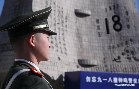 A soldier attends a ceremony to mark the anniversary of the