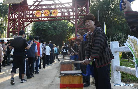 Villagers play drums to welcome guests at the entrance of Yongchu Village, Qingsong Township, Baisha Li Autonomous County, south China's Hainan Province, Nov. 17, 2019. The annual Shanlan cultural festival of Baisha kicked off here on Sunday, on which the locals celebrated the bumper harvest of local Shanlan rice and prayed for a favorable weather for farming next year together. (Xinhua/Yang Guanyu)