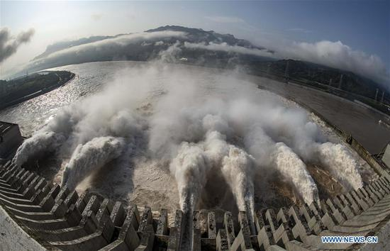 Photo taken on July 31, 2020 shows floodwater being discharged from the Three Gorges Dam in central China's Hubei Province. The third flood of China's Yangtze River this year has smoothly passed the Three Gorges Dam on Wednesday as the water-inflow rate into the reservoir has decreased to 34,000 cubic meters per second. (Xinhua/Du Huaju)