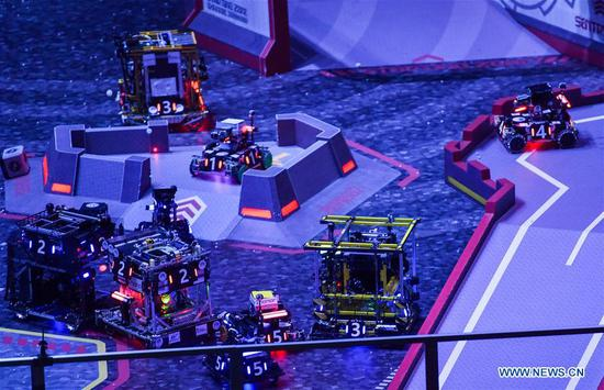 Robots designed by contestants from the South China University of Technology and the Northeastern University compete during the final of the RoboMaster 2018 competition in Shenzhen, south China's Guangdong Province, July 29, 2018. Contestants from South China University of Technology won the final on Sunday. (Xinhua/Mao Siqian)