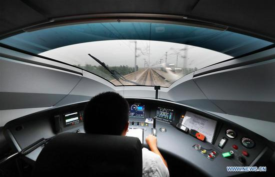 A driver works on a Fuxing bullet train running on the Beijing-Tianjin intercity rail, China, Aug 8, 2018. The speed of Fuxing bullet trains running on the Beijing-Tianjin intercity rail increased to 350 km per hour Wednesday, cutting the journey to 30 minutes. (Xinhua/Yang Baosen)
