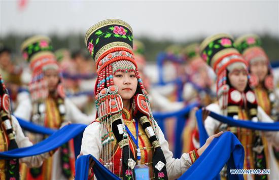 People dressed in traditional costumes perform at the Genghis Khan Chagan Suluk Nadam Fair in Ejin Horo Banner of Ordos City, north China's Inner Mongolia Autonomous Region, April 24, 2019. The two-day fair kicked off on Wednesday, including a variety of traditional activities. (Xinhua/Peng Yuan)