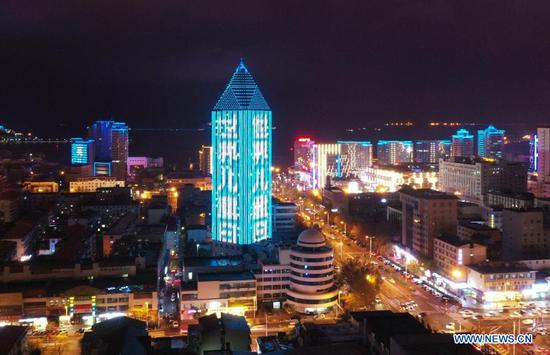 A building lights up blue on the occasion of World Children's Day in Weihai, east China's Shandong Province, Nov. 20, 2020. Buildings and iconic monuments in some Chinese cities went blue on Friday to celebrate World Children's Day. World Children's Day is celebrated on November 20 each year to promote international togetherness, awareness among children worldwide, and improving children's welfare. (Photo by Zhu Chunxiao/Xinhua)