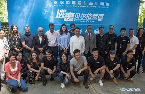 """Guests pose for a group photo at a ceremony marking the start of filming of """"Belgrade Escape"""" in Belgrade, Serbia, on July 26, 2018. Filming of """"Belgrade Escape"""" started here on Thursday, marking the first co-production movie between Serbia and China. (Xinhua/Nemanja Cabric)"""