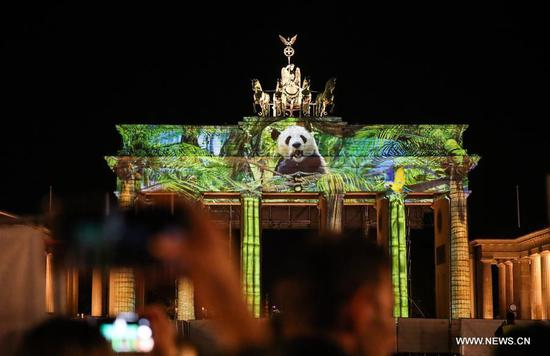 The illuminated Brandenburger Gate is seen during the 2018 Festival of Lights in Berlin, capital of Germany, on Oct. 5, 2018. Berlin turned into a city of light art with the opening of its Festival of Lights on Friday which will last from Oct. 5 to Oct. 14. (Xinhua/Shan Yuqi)