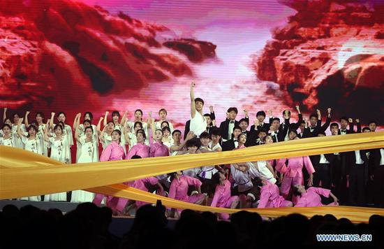 Students from Shanghai University of Finance and Economics and Shanghai Theatre Academy perform during a chorus event in Shanghai, east China, April 29, 2019. A chorus event was held on April 29, 2019 in Shanghai to commemorate the centenary of May Fourth Movement. Some 6,000 youths from local schools attended the event. (Xinhua/Liu Ying)