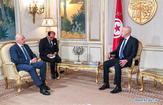 "Tunisian President Kais Saied (R) meets with Greek foreign minister Nikos Dendias (L) in Tunis, capital of Tunisia, June 29, 2020. During the meeting, Kais Saied discussed with the Greek foreign minister ways and means of further strengthening bilateral relations, in addition to regional and international issues of common interest, in particular ""the chaotic situation in Libya."" (Tunisian Presidency/Handout via Xinhua)"