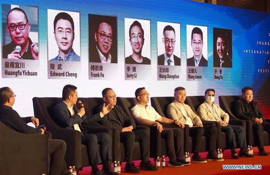 Experts talk about how to resume film work during a forum of the opening ceremony of the Shanghai International Film Festival in Shanghai, east China, July 25, 2020. Shanghai International Film Festival opened here on Saturday, which will be held both online and offline. (Xinhua/Ren Long)
