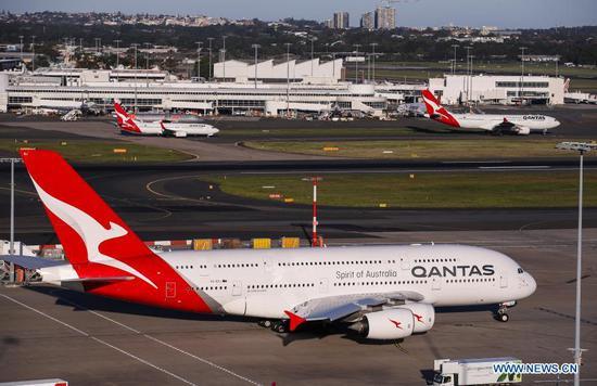 File photo taken on March 18, 2020 shows Qantas airplanes at Sydney Airport, in Sydney, Australia. Australia's national airline Qantas has resumed bookings for international flights from July 1 this year, in a promising sign that overseas travel might return sooner than expected. (Xinhua/Bai Xuefei)