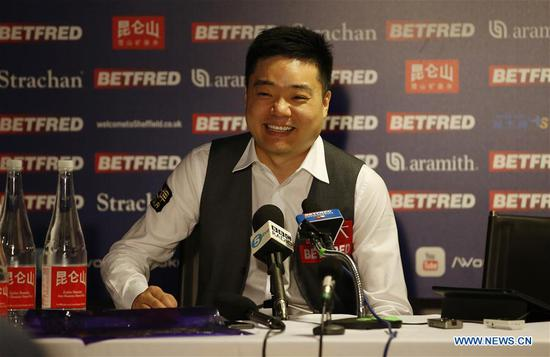 Ding Junhui of China speaks in the post match press conference after winning the first round match against his compatriot Xiao Guodong at the World Snooker Championship 2018 at the Crucible Theatre in Sheffield, Britain on April 24, 2018. (Xinhua/Craig Brough)