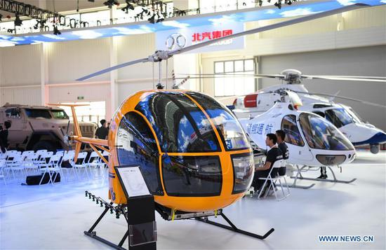 Photo taken on Nov. 5, 2018 shows a civil helicopter at the exhibition area of the upcoming China International Aviation and Aerospace Exhibition in Zhuhai, south China's Guangdong Province, Nov. 5, 2018. The exhibition is scheduled to be held on Nov. 6-11. (Xinhua/Deng Hua)