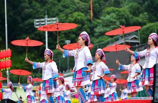 People celebrate the Longji Terrace Culture Festival in Longsheng County, south China's Guangxi Zhuang Autonomous Region, June 17, 2019. People of various ethnic groups gathered here to showcase their culture during the festival. (Xinhua/Pan Zhixiang)