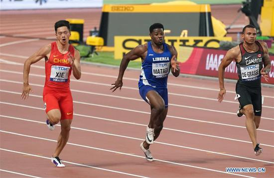 Xie Zhenye (L) of China competes during the men's 100m semi-final at the 2019 IAAF World Athletics Championships in Doha, Qatar, on Sept. 28, 2019. (Xinhua/Xu Suhui)