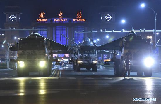 Equipment to be reviewed in the military parade marking the 70th anniversary of the founding of the People's Republic of China (PRC) is seen near the Beijing Railway Station in Beijing, capital of China, Oct. 1, 2019. (Xinhua/Qian Yi)