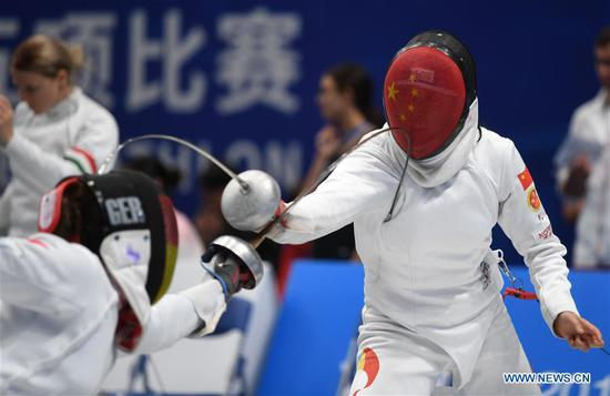 China's Zhong Xiuting (R) competes during the women's individual fencing final of modern pentathlon at the 7th CISM Military World Games in Wuhan, capital of central China's Hubei Province, Oct. 24, 2019. (Xinhua/Li Ga)