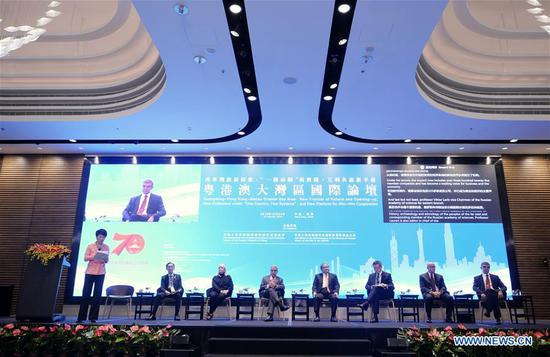 Guests attend a forum on the development of the Greater Bay Area in Hong Kong, south China, Oct. 24, 2019. The Guangdong-Hong Kong-Macao Greater Bay Area of China is developing into a model of regional synergy, a driver of the country's new round of opening-up, and a source of fresh opportunities to be shared by the world. Officials, scholars and business representatives assembled here at a forum on Thursday to discuss the development of the Greater Bay Area, one of the most dynamic region across the world. (Xinhua/Wang Shen)