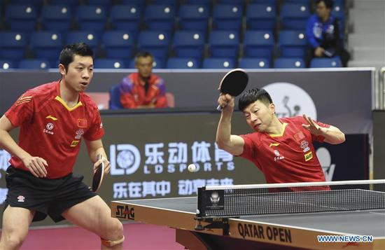Ma Long (R)/Xu Xin of China compete during the men's doubles round of 16 match between Ma Long/Xu Xin of China and Anton Kallberg/Jon Persson of Sweden at 2020 ITTF Qatar Open in Doha, Qatar, March 5, 2020. (Photo by Nikku/Xinhua)