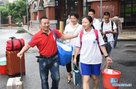 Students leave an exam venue at a middle school in Guangzhou, south China's Guangdong Province, June 8, 2018. The national college entrance examination ended in some places of China on Friday. (Xinhua/Lu Hanxin)