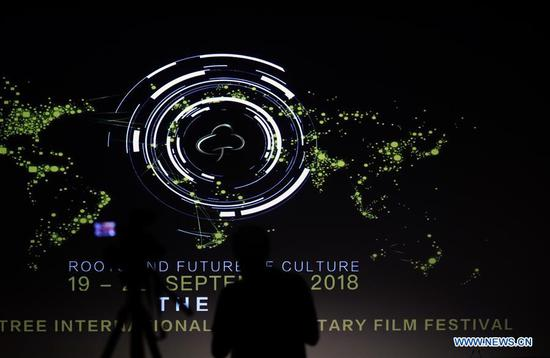 A member of the media works at the opening ceremony of the third Golden Tree International Documentary Film Festival in Frankfurt, Germany, Sept. 19, 2018. (Xinhua/Luo Huanhuan)