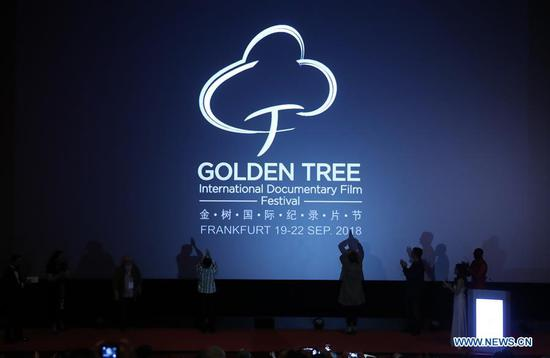 Guests applaud as the third Golden Tree International Documentary Film Festival is unveiled in Frankfurt, Germany, Sept. 19, 2018. (Xinhua/Luo Huanhuan)