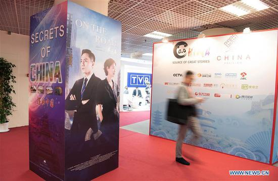 A man walks past a poster of Chinese TV series during the 2019 Cannes International Series Festival, or Canneseries 2019, in Cannes, France, April 8, 2019. Many TV series, documents and cartoons presented by Chinese exhibitors drew people's attention during the big event running from 5 to 10 April. (Xinhua/Jack Chan)