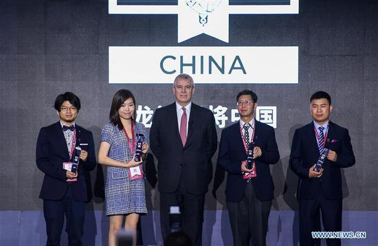 British Prince Andrew (C), the Duke of York, poses for a group photo with the winners during the final of Pitch@Palace China in Shenzhen, south China's Guangdong Province, April 14, 2019. Founded by British Prince Andrew in 2014 to support the Duke's work with entrepreneurs, Pitch@Palace (meaning making a pitch at the palace) is a platform that supports entrepreneurs accelerate and amplify their ideas. Pitch@Palace China started in 2017, aiming to provide comprehensive and important support to outstanding entrepreneurs by consolidating quality resources from both China and UK. (Xinhua/Mao Siqian)