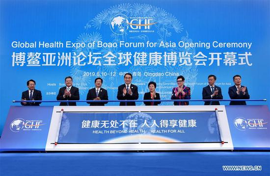 Delegates attend the opening ceremony of the Global Health Forum (GHF) of Boao Forum for Asia (BFA) at Qingdao World Expo City in Qingdao, east China's Shandong Province, on June 10, 2019. Themed with