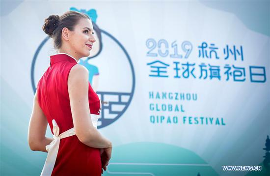 A model presents cheongsam, a traditional Chinese dress also known as Qipao, during a cheongsam show in Vienna, Austria, on Aug. 27, 2019. The 2019 Hangzhou Global Qipao Festival was held in Vienna on Tuesday. (Photo by Wang Zhou/Xinhua)