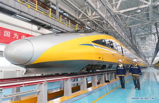 Staff members of China Railway Seventh Group Co., Ltd. check a bullet train at a maintenance station in Changping District of Beijing, capital of China, Oct. 7, 2019. The maintenance station was put into use as Beijing-Zhangjiakou high-speed railway started joint debugging last week. The high-speed railway is 174 kilometers long, with a maximum design speed of 350 kilometers per hour. The railway line, as a major project for the 2022 Olympic and Paralympic Winter Games, is expected to be finished by the end of 2019. (Xinhua/Ma Ning)