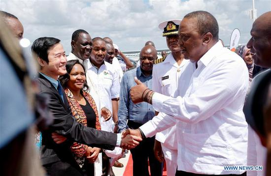 Kenyan President Uhuru Kenyatta (R) attends the launching ceremony of the 50 MW solar power farm in Garissa, Kenya, Dec. 13, 2019. The plant, designed and built by the EPC contractor China Jiangxi Corporation for International Economic and Technical Co-operation (CJIC), in conjunction with Kenya's Rural Energy Authority (REA), is one of the largest photovoltaic electricity stations in Africa. (Xinhua/Yang Zhen)
