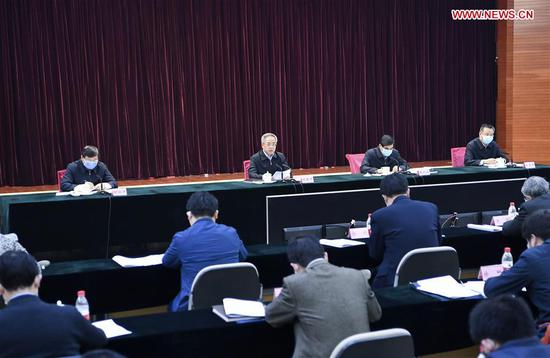 Chinese Vice Premier Hu Chunhua, also a member of the Political Bureau of the Communist Party of China Central Committee, makes remarks at a teleconference on employment work amid the novel coronavirus outbreak in Beijing, capital of China, Feb. 13, 2020. (Xinhua/Zhang Ling)