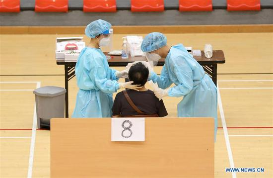 Staff work at a COVID-19 testing center at a gymnasium in Hong Kong, south China, Sept. 4, 2020. Hong Kong on Monday evening completed its mass COVID-19 screening program launched two weeks ago, with the participation of some 1.78 million residents in total. (Xinhua/Wu Xiaochu)