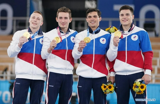 Players of ROC pose during the awarding ceremony for the artistic gymnastics men's team final at the Tokyo 2020 Olympic Games in Tokyo, Japan, July 26, 2021. (Xinhua/Cheng Min)