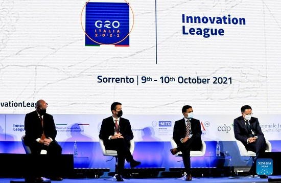 Representatives attend a meeting of the G20 Innovation League in Sorrento, southern Italy, on Oct. 10, 2021. Chinese startup Sansure Biotech on Sunday won the award for healthcare innovation at the G20 Innovation League, a competition between 100 startups from over 20 countries. Held both in presence and online over the weekend in the southern Italy's city of Sorrento, the competition saw five groups of twenty startups proposing innovative products and solutions in five different competitive sessions, each concerning one of the five main challenges currently faced by mankind: Cleantech, Artificial Intelligence (AI), Internet of Things and Wearables, Smart Cities and Mobility, and Healthcare. (Xinhua/Liu Yongqiu)